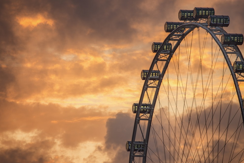 Ferris Wheel on the background of evening sky